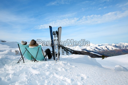 couple of skiers relaxing in long