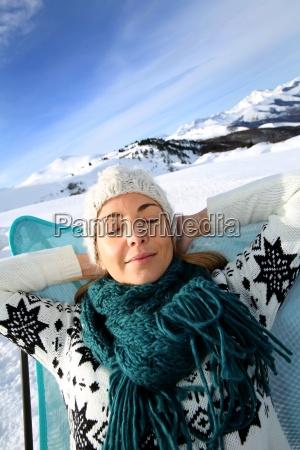 woman in ski resort relaxing in