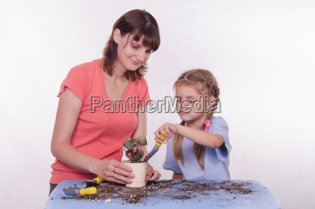 mom and daughter in land sprinkled