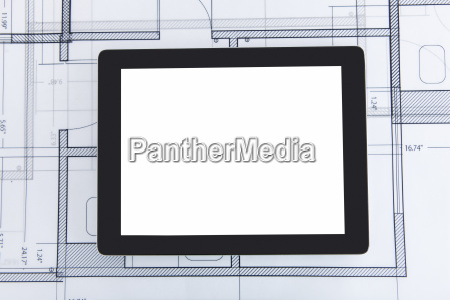digital tablet on blueprint