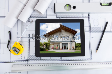 digital tablet with architects tools over