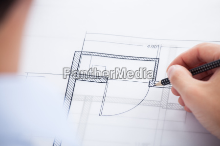 cropped image of architect working on