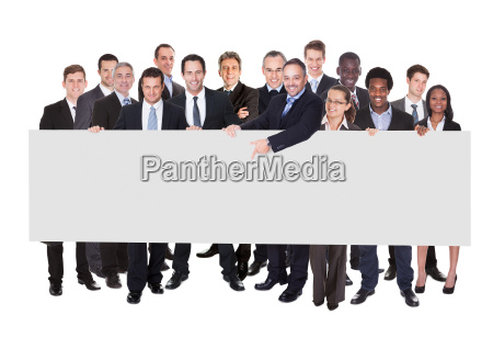 multiethnic businesspeople holding blank billboard