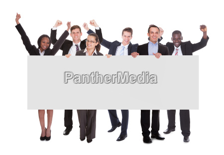 successful businesspeople holding blank billboard