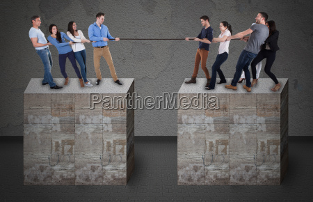 friends playing tug of war on