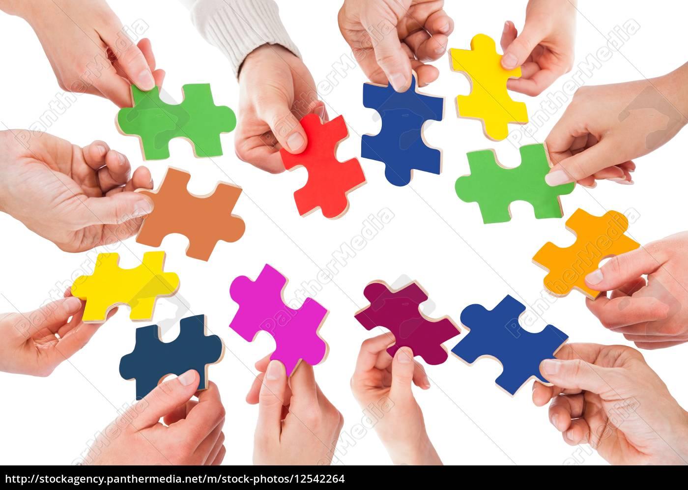 Lizenzfreies Foto 12542264   Fünf Personen Hand Mit Puzzle