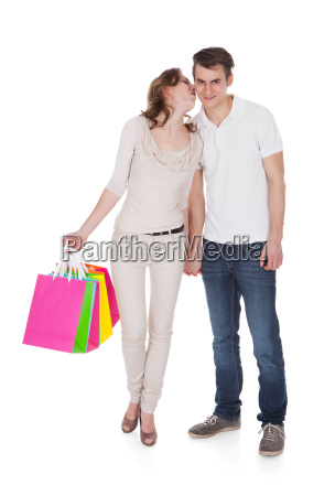 couple with shopping bags over white