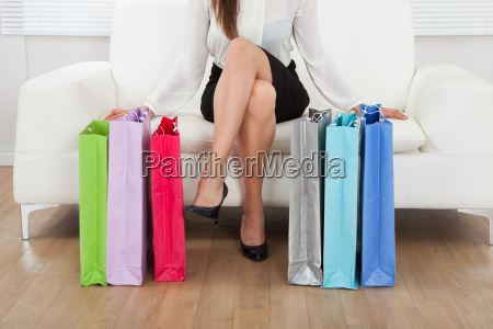 woman with multicolored shopping bags at