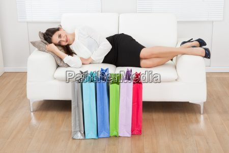 woman lying on sofa with multicolored
