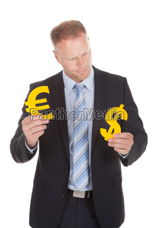 businessman choosing between euro and dollar