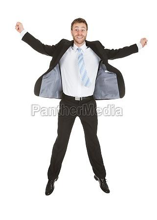 portrait of businessman celebrating success