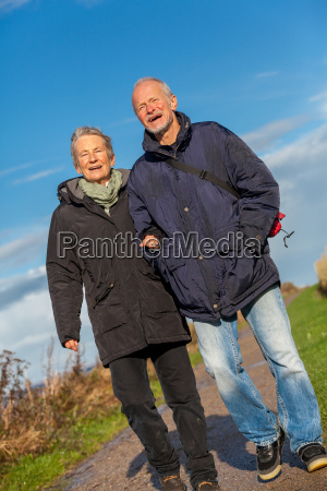 senior happy couple makes a walk
