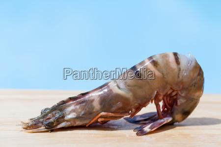 fresh shrimp on a wooden board