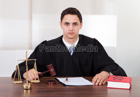 confident judge sitting in courtroom
