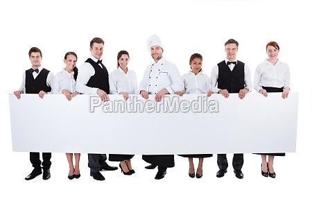 gruppe von catering personal eine leere