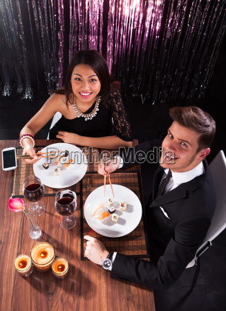 couple having meal at restaurant