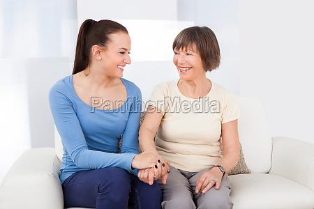 caregiver consoling senior frau
