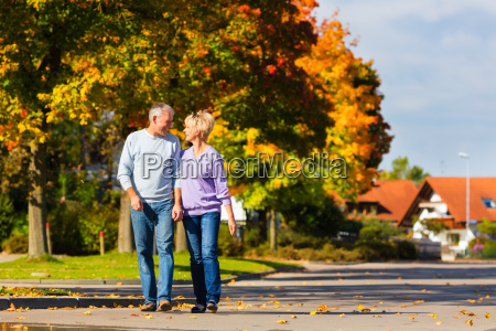seniors in the autumn on walk