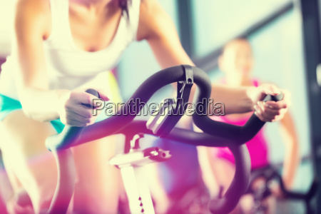 people at spinning at a gym