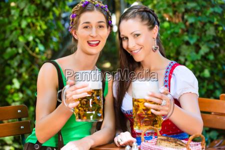 in beer garden friends drinking