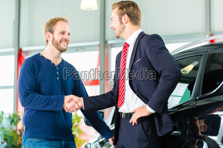seller and customer with new car