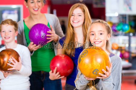family in the bowling center