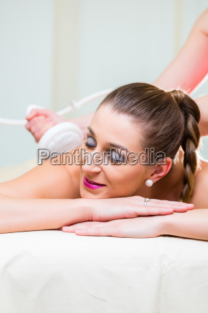 woman gets back massage in the
