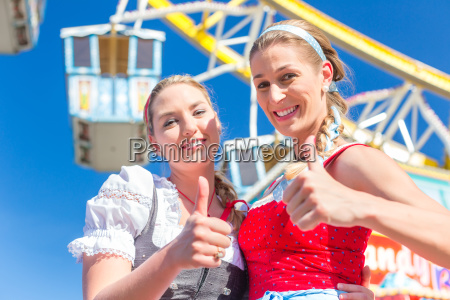 girlfriends visit fairground have fun
