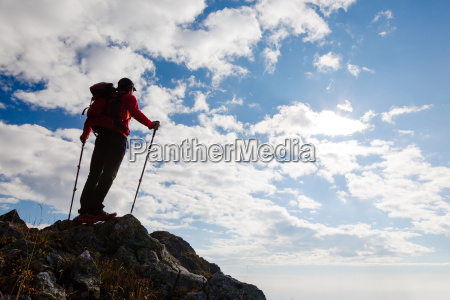 hiker standing on the top of