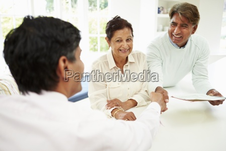 senior indian couple meeting with financial