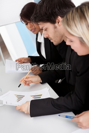 group of business people looking at