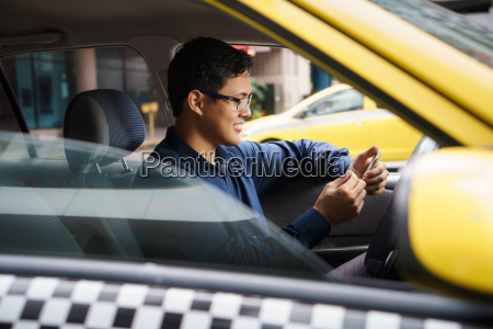 taxi driver driving car happy counting
