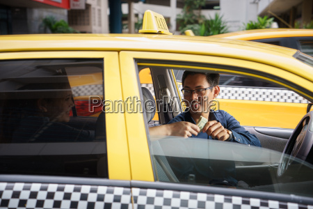 taxi driver driving car happy client