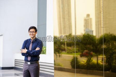 portrait proud happy confident asian office