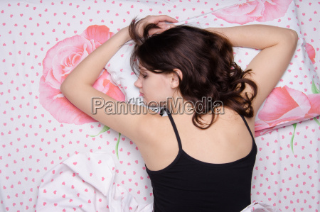 girl sleeping on her stomach in