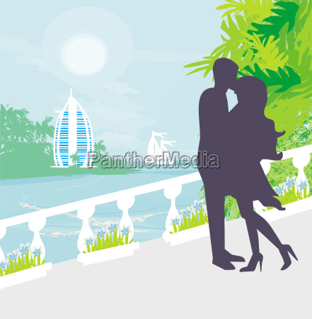 couple kissing tropical vacation