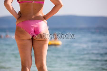 woman in pink bikini at a
