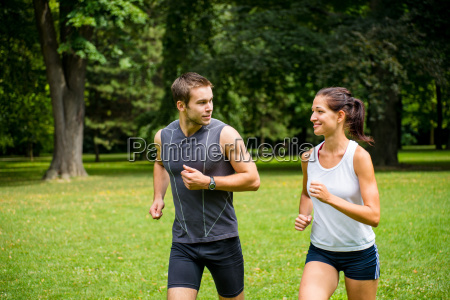 training together young couple jogging