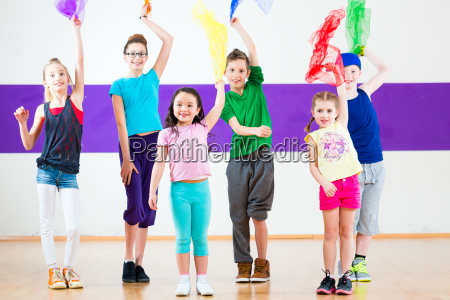 children work in dance school