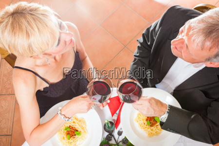 mature couple festive dinner in the