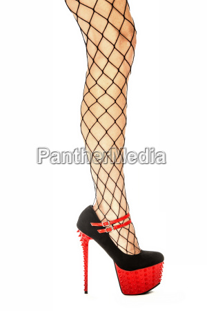 sexy legs in fishnet stockings and