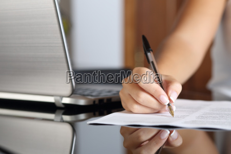 woman hand writing a contract with