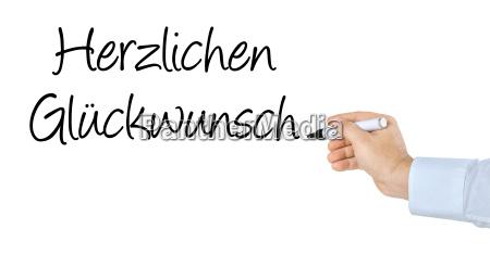 hand mit stift schreibt herzlichen glueckwunsch