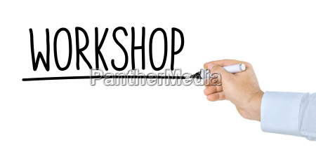 hand mit stift schreibt workshop