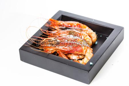 grilled shrimp in black plate on