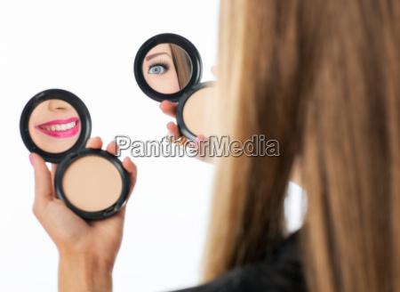 woman checking her makeup