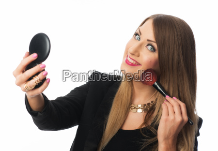 woman holding hand mirror