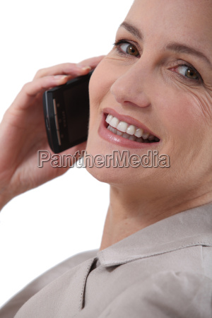 woman stuck to the phone