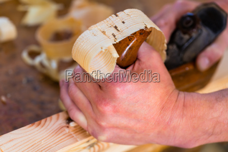 joiners or carpenters with planer in