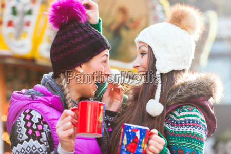 friends drink mulled wine on christmas